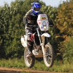 Husqvarna TE630 Rally bike airborne over a jump.